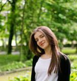 Pretty Girl in Green Park Royalty Free Stock Photo