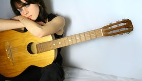 Pretty girl with guitar Stock Photography