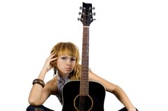 Pretty girl with guitar. Pretty, blonde girl holding guitar, happy musician in country style Royalty Free Stock Photos