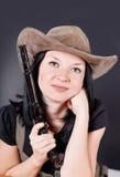 Pretty girl with a gun Stock Photo