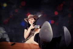 Pretty girl with a gun cowboy Royalty Free Stock Photos