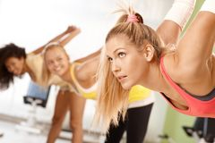 Pretty girl at the gym. Pretty girl exercising at the gym in group Stock Image