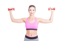 Pretty girl at gym holding pair of dumbbells Royalty Free Stock Photography
