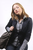 Pretty girl with handbag looking at camera Royalty Free Stock Images