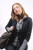 Pretty girl with handbag looking at camera royalty free stock images