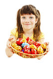 A pretty girl happy with her Easter eggs Stock Photos