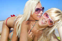 Pretty girl has a fun with her girlfriend royalty free stock photography