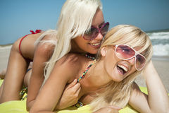 Pretty girl has a fun with her girlfriend Stock Images