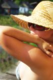 Pretty girl in hat. Portrait of young beautiful woman in straw hat and sunglasses Stock Photography