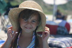 Pretty girl in hat. A young cute girl wearing a hat at the beach stock images