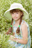 Pretty girl in a hat with braids royalty free stock photo