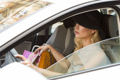 Pretty girl with hat driving Stock Images