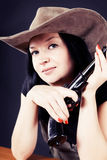 Pretty girl in a hat with a gun Stock Photos