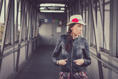 Pretty girl with hat and leather jacket posing Stock Photos