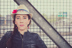 Pretty girl with hat and leather jacket posing Royalty Free Stock Photography