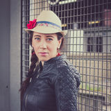 Pretty girl with hat and leather jacket posing Stock Photography