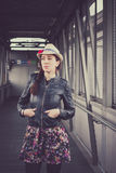 Pretty girl with hat and leather jacket posing Royalty Free Stock Images