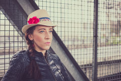 Pretty girl with hat and leather jacket posing Royalty Free Stock Photos