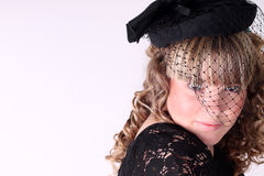 Pretty girl with a hat and long curly hair Royalty Free Stock Image