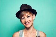 Pretty girl with a hat and a positive attitude stock images