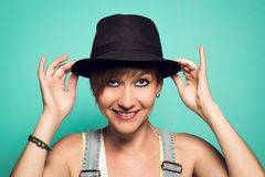 Pretty girl with a hat and a positive attitude stock image