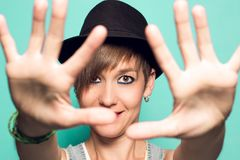 Pretty girl with a hat and a positive attitude royalty free stock image