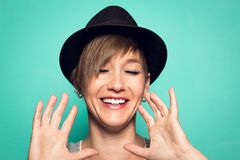 Pretty girl with a hat and a positive attitude stock photo