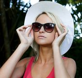 Pretty Girl in Hat and Sunglasses Royalty Free Stock Photo