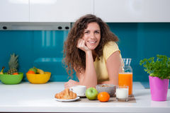 Pretty girl having breakfast Royalty Free Stock Photography