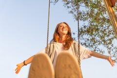 Pretty girl having fun on a swing Royalty Free Stock Photography