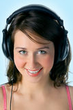 Pretty girl in head phones Stock Photos
