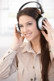 Pretty girl with headphones smiling Stock Photography