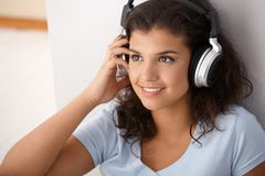 Pretty girl with headphones smiling Royalty Free Stock Photography