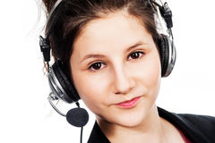 Pretty girl with headset. Pretty girl looking to camera with headphone and microphone headset. Studio shot on white background Stock Image