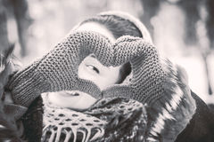 Pretty girl with heart shaped hands in the gloves Royalty Free Stock Photo