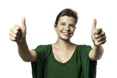 Pretty girl helds her two thumbs up Royalty Free Stock Images