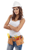 Pretty girl with helmet and belt of tools Stock Images