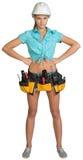 Pretty girl in helmet, shorts, shirt and tool belt Stock Photo