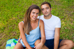 Pretty girl and her boyfriend are cuddling in park Stock Photo