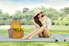 Pretty girl and her dog sitting at field Stock Photos