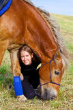 Pretty girl with her horse Stock Photos
