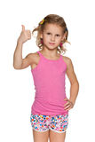Pretty girl with her thumb up Stock Images