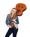 Pretty girl with hippie clothes and a guitar Royalty Free Stock Photos