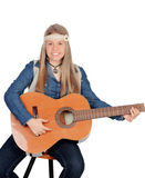 Pretty girl with hippie clothes and a guitar Stock Image