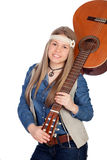 Pretty girl with hippie clothes and a guitar Royalty Free Stock Photo