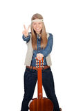 Pretty girl with hippie clothes and a guitar Royalty Free Stock Image