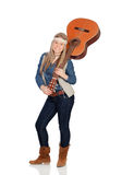 Pretty girl with hippie clothes and a guitar Stock Photography