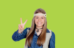 Pretty girl with hippie clothes making the peace symbol Royalty Free Stock Images