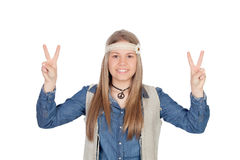 Pretty girl with hippie clothes making the peace symbol Royalty Free Stock Photo