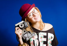 Pretty girl in hipster glasses and hat holding Royalty Free Stock Photography